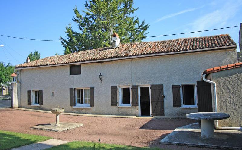 Long low farm house style property with shutters and a large garden in Charente, France