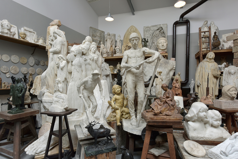 Sculptures in an artists studio in various states of readiness, typical early 20th century Parisian style
