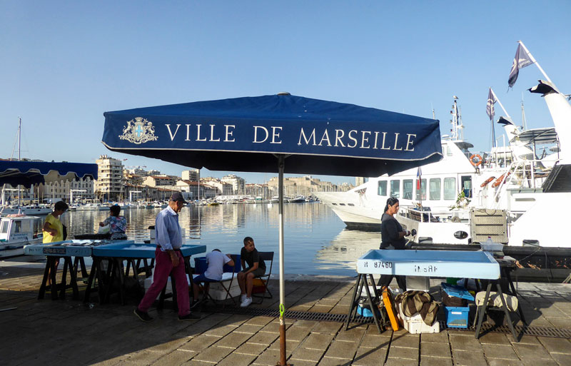 The old port of Marseille, southern france, boats in the harbour, fishermen on the quayside selling fresh fish