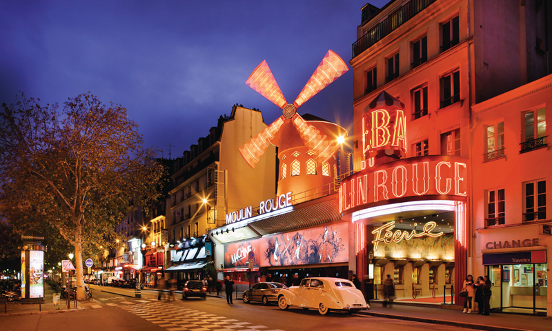 Moulin Rouge cabaret Paris lit up at night