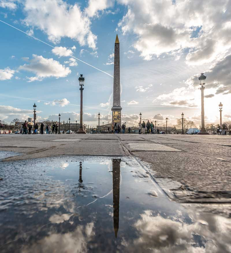 Cleopatra's Needle Paris reflected in a rain puddle