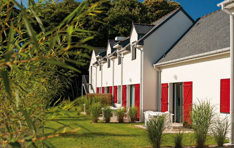 Charming holiday cottages with red shutters at Queven Brittany