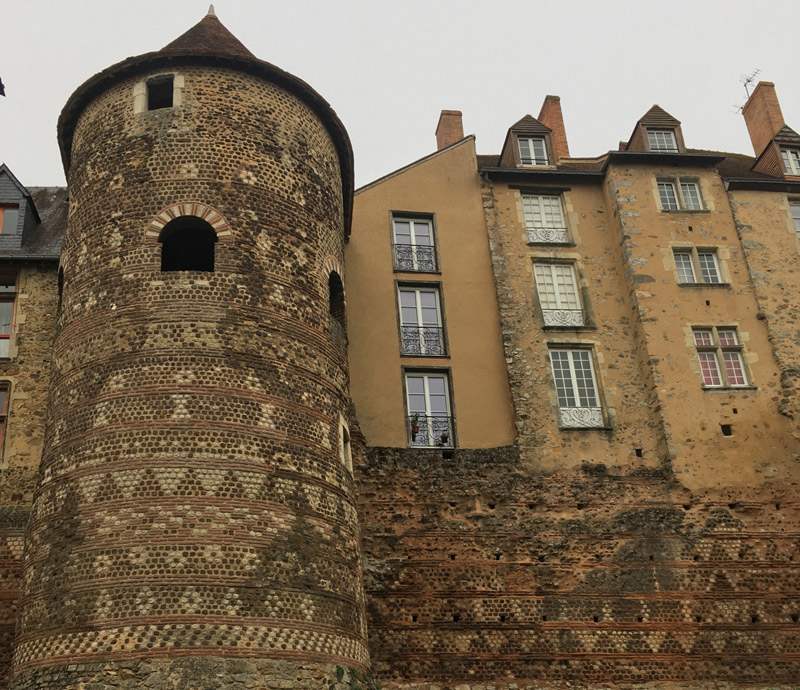 Enormous Roman tower with fancy brickwork incorporated into a block of newer buildings in Le Mans, France