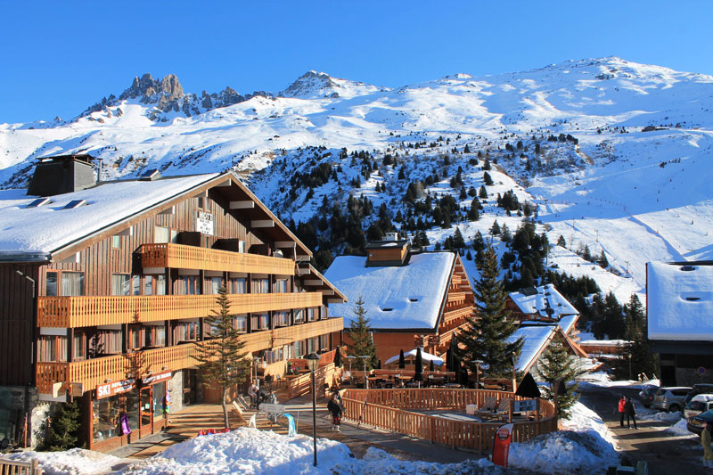 Ski lodges on a snowy mountain in Meribel France