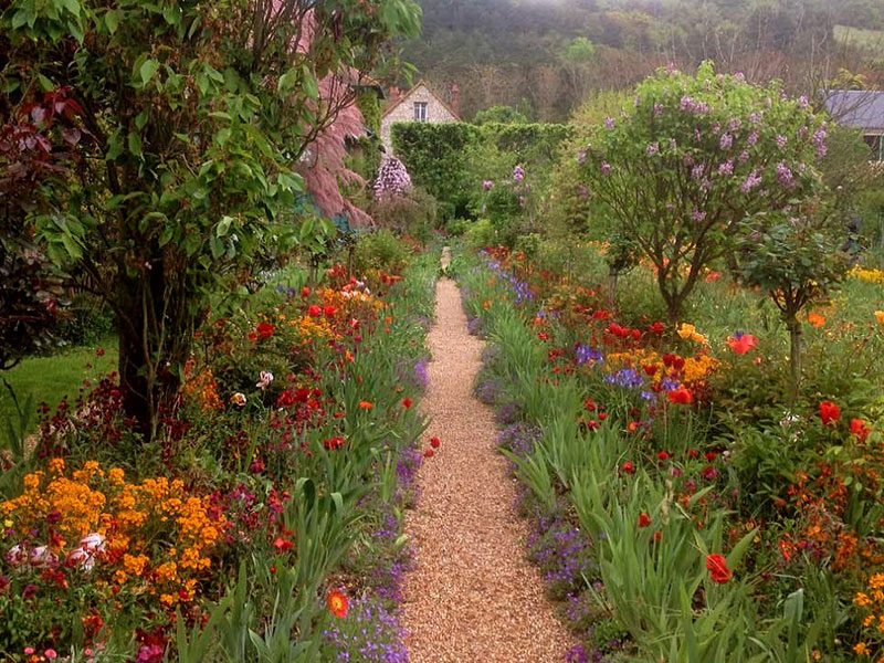 Path running through a gorgeous garden filled with colourful flowers, Monet's garden Giverny France