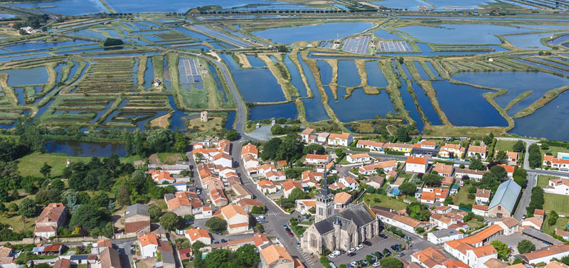 Huge area of salt marshes in Les Sables d'Olonne, blue water separated by grassy green paths