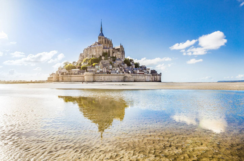 Mont St Michel, a medieval island town in Normandy topped by a majestic abbey