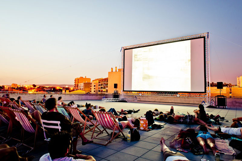 Open air cinema on a roof top in Marseille at a cultural centre called La Friche la Belle de Mai