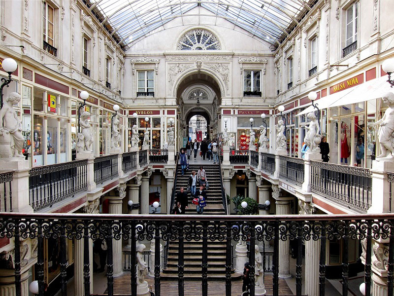 Beautiful shopping centre with wrought iron railings, glass roof and statues lining its walk ways in Nantes