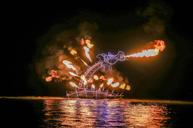 Incredible firework display in the shape of a fire breathing dragon on the river Bordeaux