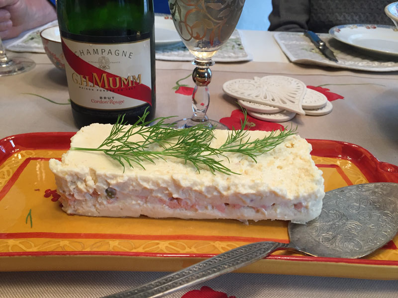 Home made terrine with a bottle of Mumm Champagne