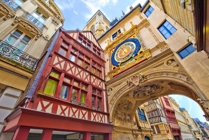 Rouen city, in a cobbled street lined with half timbered buildings, a riot of colour