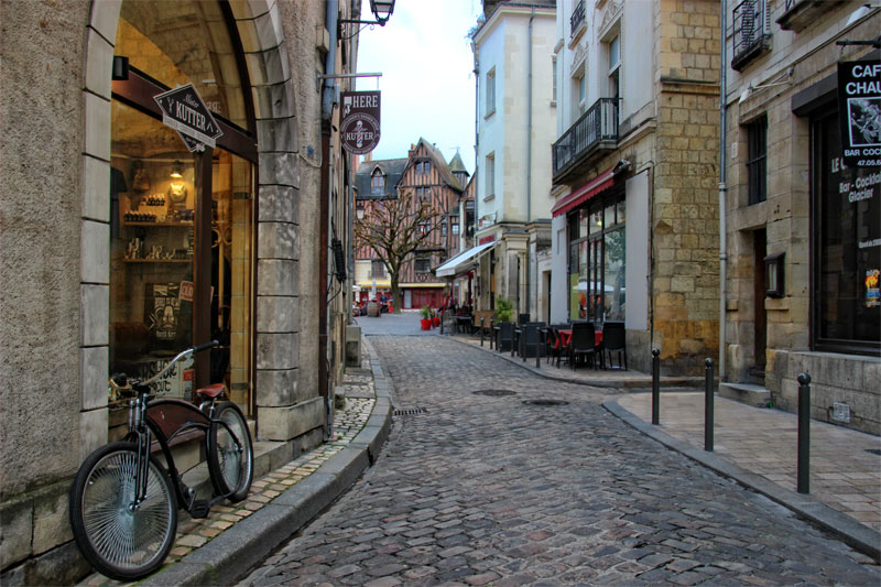 Cobbled streets, lined with half-timbered houses and shops in ancient buildings in Tours, Loire Valley