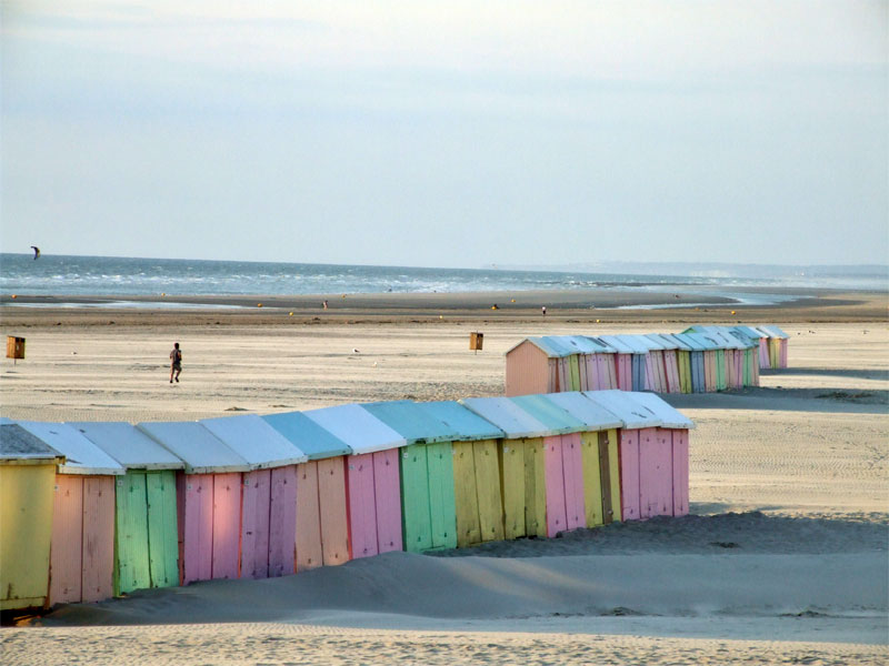 Pastel coloured beach huts on the sand on a sunny day at Berck-sur-Mer, Opal Coast, northern France