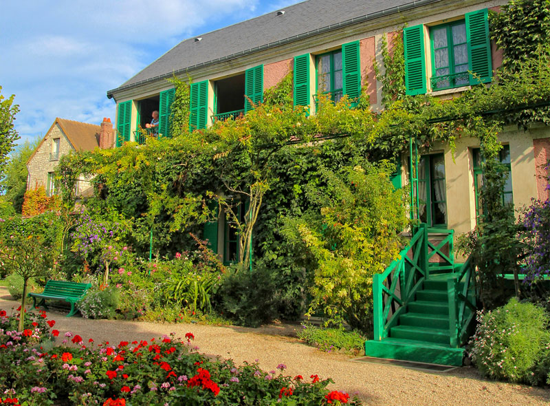 Facade of Claude Monet's house in Normandy, plants growing up the walls