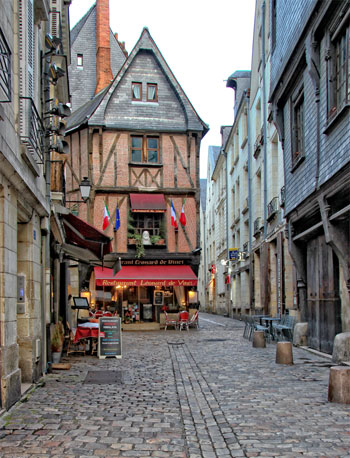A vibrant brasserie in a half timbered house on a narrow cobbled street in Tours, Loire Valley