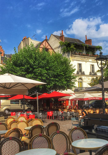 Place Plumereau in Tours is filled with tables and chairs from bars and restaurants