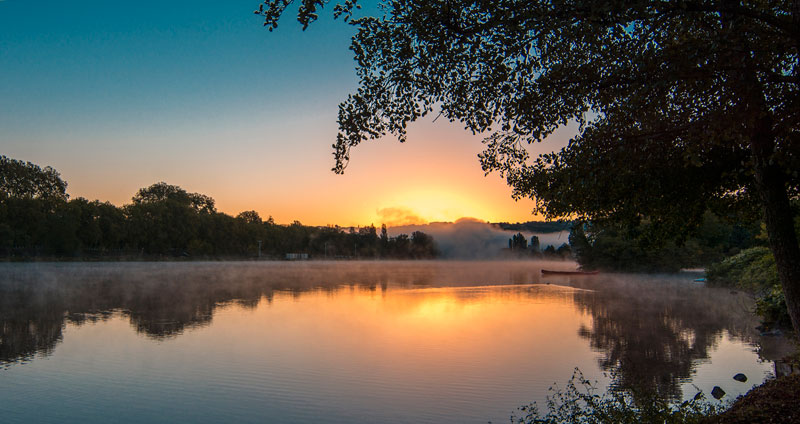 The late at Vichy as the sun rises, mist coming off the lake