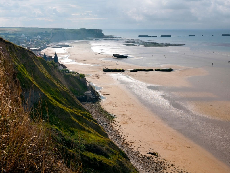 Arromanches coast line in Normandy, France, a historic scene of WWII, now a bucket & spade holiday destination