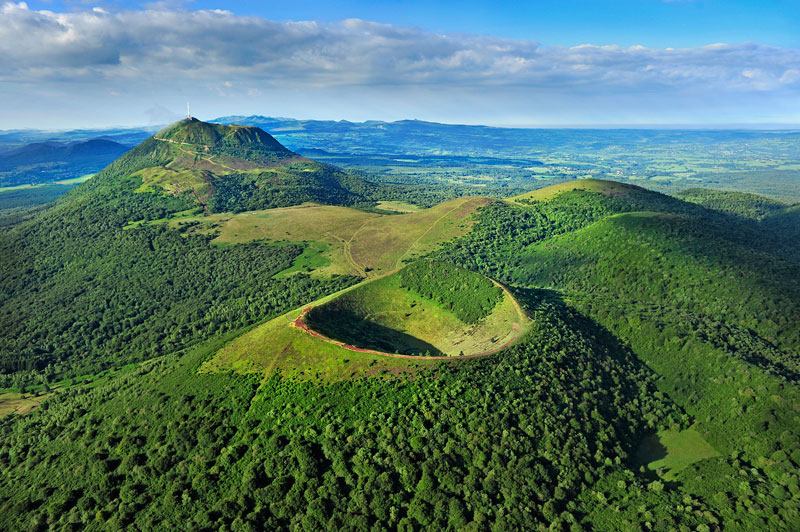 Extinct volcanoes in Auvergne France, now covered with green vegetation