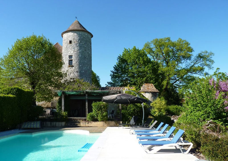 Swimming pool with a castle tower in the background