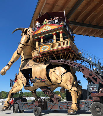 A giant mechanical Minotaur carries passengers on his back in Toulouse