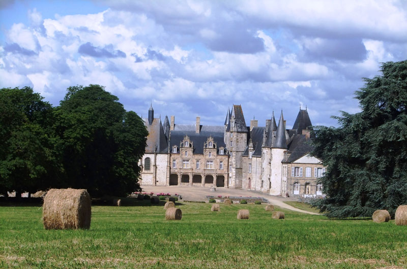 Chateau with pointy turrets at Mezaner, Mayenne, France