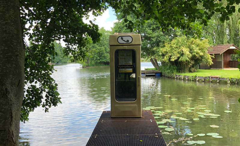 A phone box art installation on a bridge in Amiens