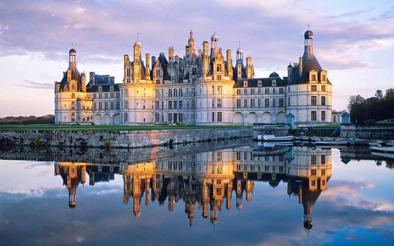 Dozens of towers and turrets reach for the sky at the Chateau of Chambord in the Loire Valley