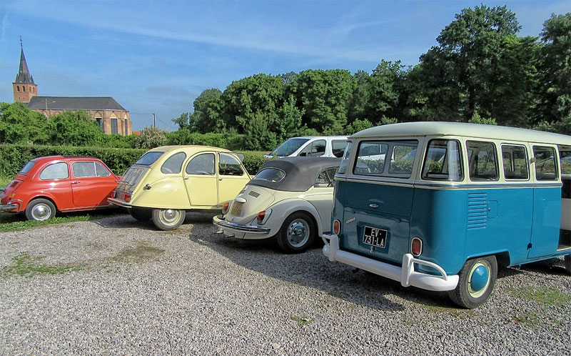 Vintage vehicles in France including 2CV and VW Camper vans