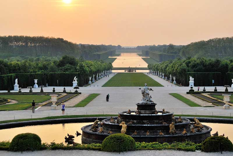 Sunset over the gardens of the Chateau of Versailles