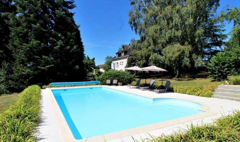 Swimming pool in the garden of a gite in Dordogne