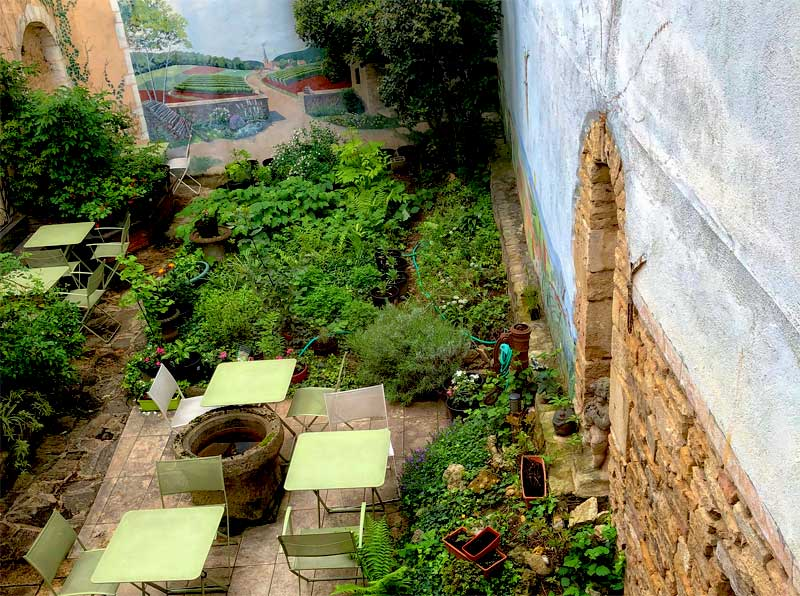 Overlooking a fairy tale style courtyard at the ancient Mailson Milliere restaurant in Dijon