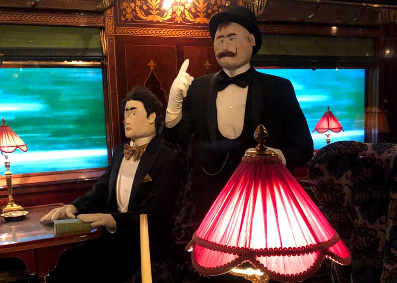 Mannequin of literary character Hercule Poirot on the Orient Express at Mulhouse train museum
