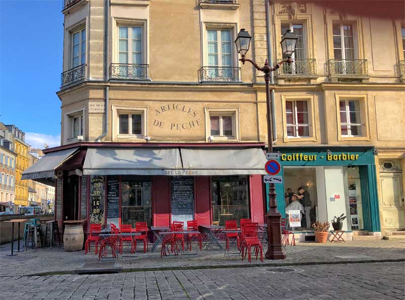Cobbled street and shops in Versailles town France