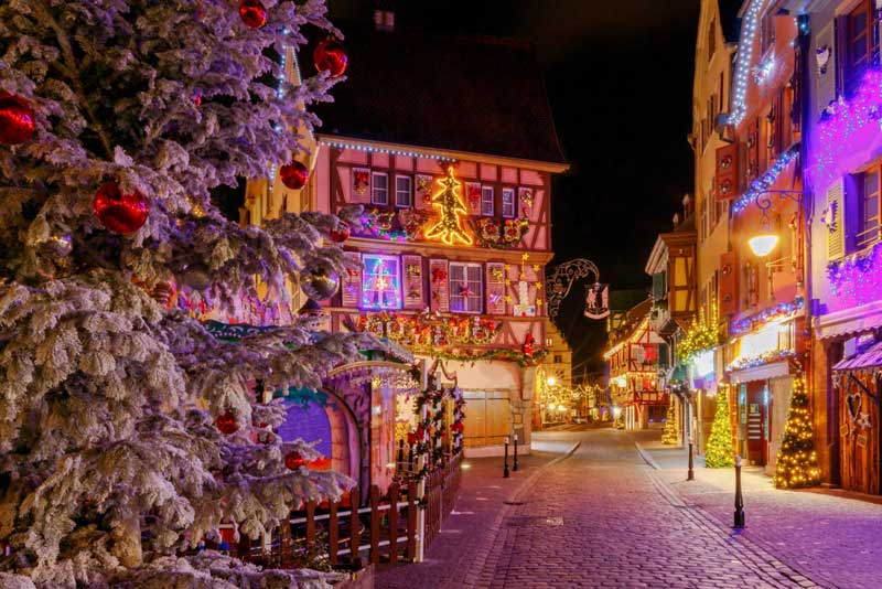 Cobbled street lined with half timbered houses decorated for Christmas