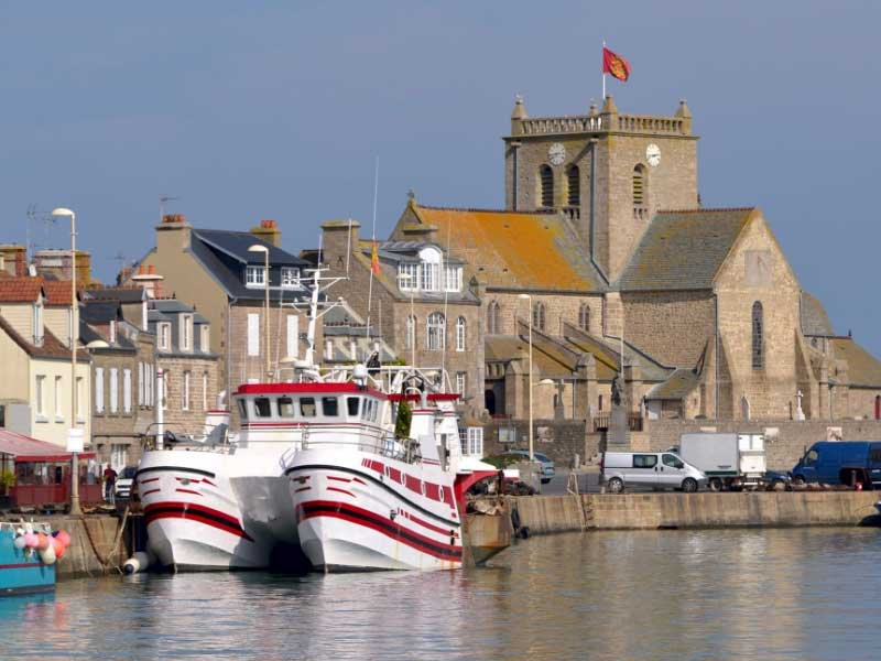 Pretty port town with colourful boats bobbing in the harbour in Barfleur, Normandy