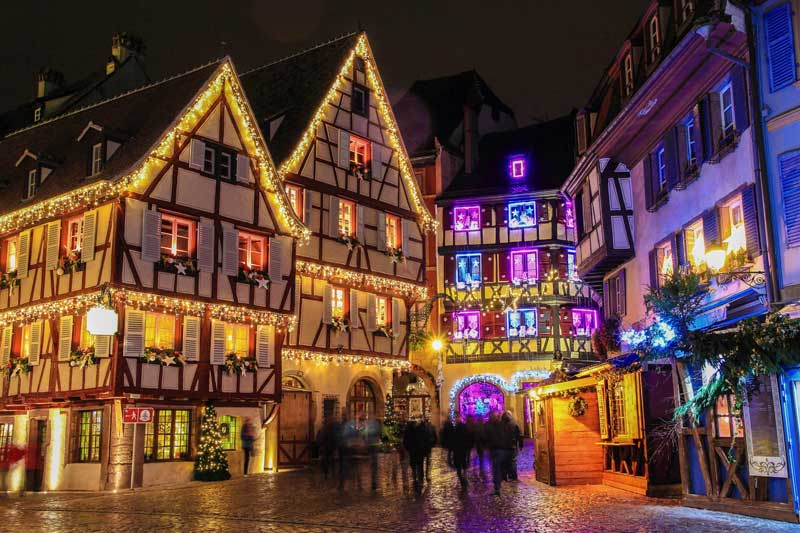 Cobbled street of half timbered houses with Christmas lights and decorations in Colmar, Alsace