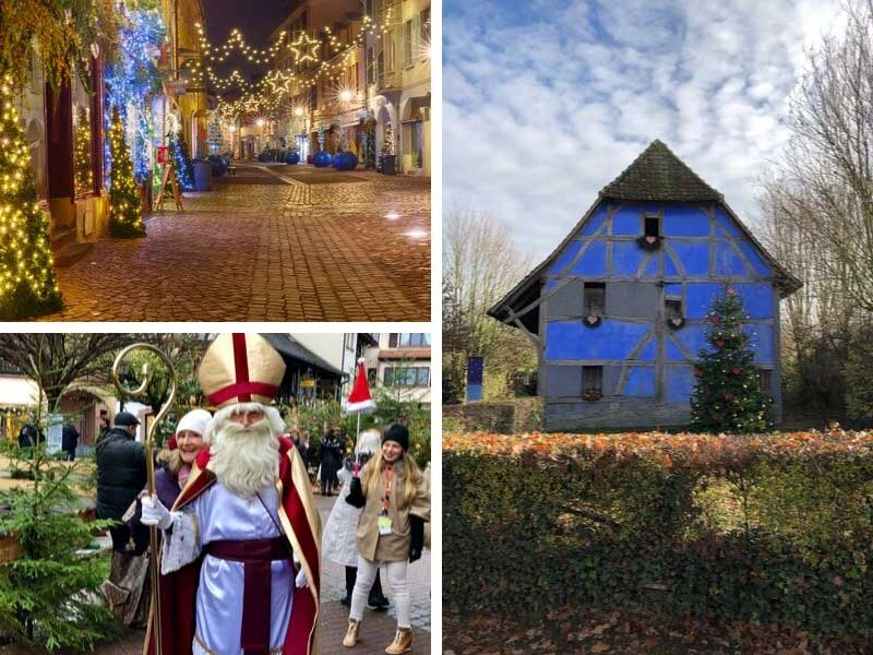 Pretty houses decorated for Christmas as Father Christmas parades through a street in Alsace, France