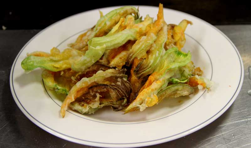 Courgette flowers deep fried and stuffed with goats cheese