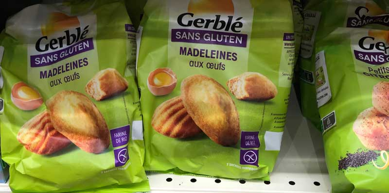 Packets of little cakes in a supermarket in France with the words sans gluten - gluten free