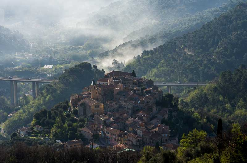 Perched town of Gorbio in Cote d'Azur, France, surrounded by trees, like a stony oasis