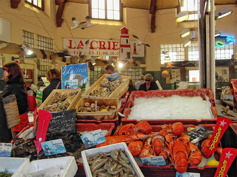 Fish and lobsters displayed at an art deco style indoor market at Le Touquet