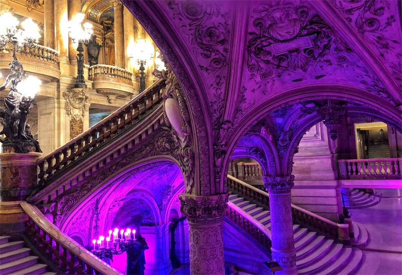 The central staircase of the Paris Opera House lots of gold, candles and statues