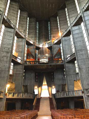 Inside the concrete church of Notre Dame in Royan, hundreds of tiny windows provide light