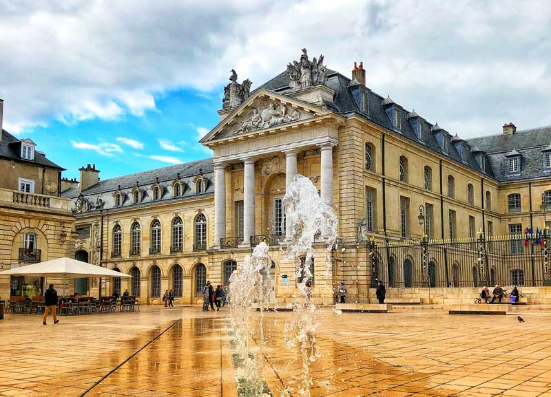 Fountains on a grand paved square before the Palace of the Dukes in Dijon