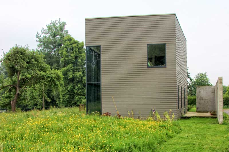 Cube shaped house in a field of wild flowers in Pas de Calais northern France