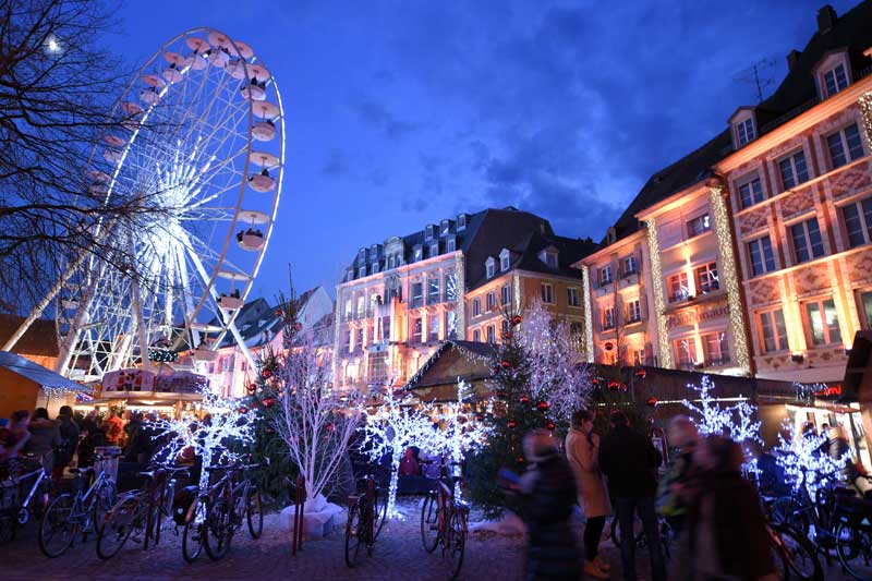 Ferris Wheel and Christmas chalets at Mulhouse Christmas Market