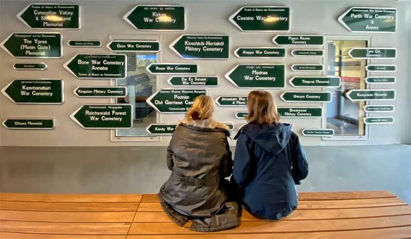 Two women looking at metal war grave signs at the Commonwealth Graves Commission Experience in Arras, France