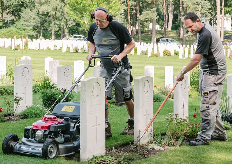 Two men gardening at a Commonwealth Graves Commission cemetery